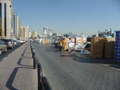 Goods line the waterway in Old Dubai