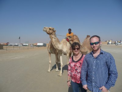 We jumped out of the car to pose with this camel and rider