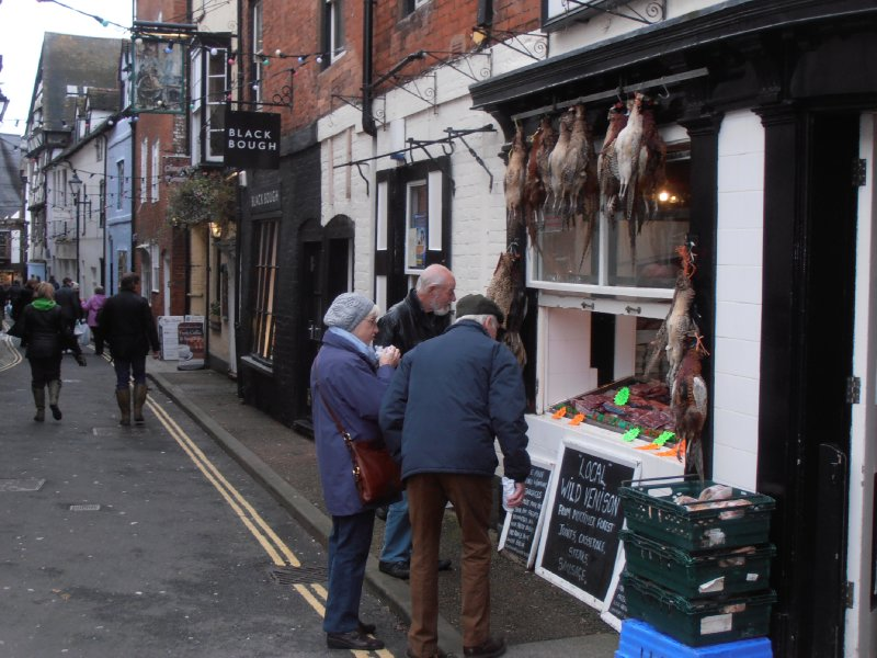 The Locals Examine the Offerings at The Ludlow Butcher's