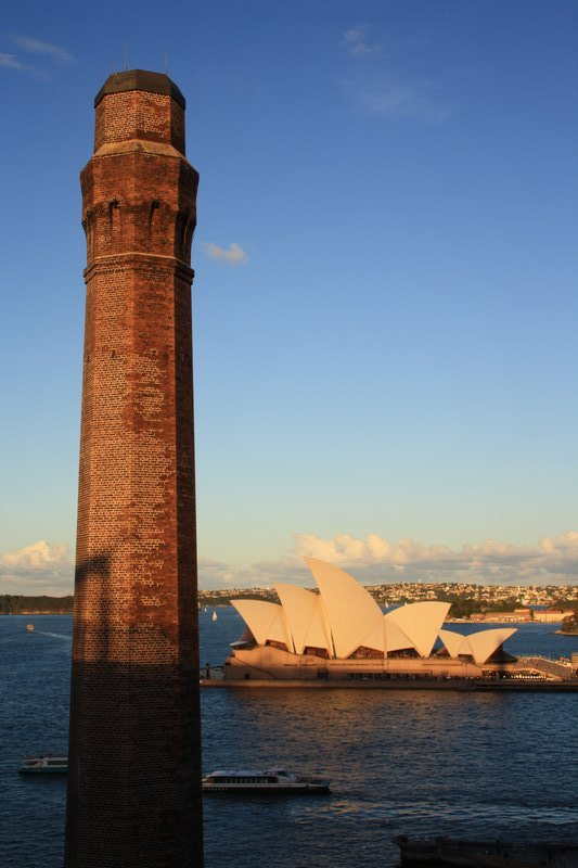 A sunset view of the opera house from Sydney bridge. beautiful.