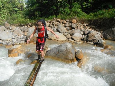 Crossing a makeshift bridge en route to Mt Apo