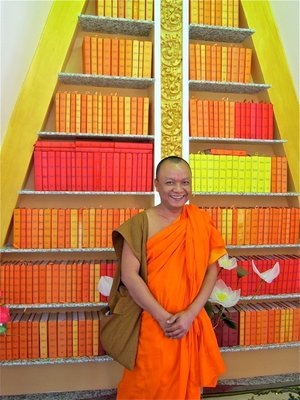 Our monk friend in front of his library