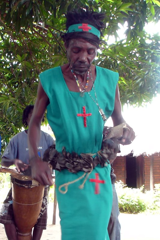 Witch doctor dancing and eating charcoal