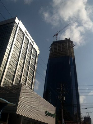 Tall buildings and construction cranes are seen throughout the modern Panama City.