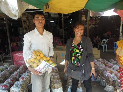 .Shopping is done. Two bags of longans