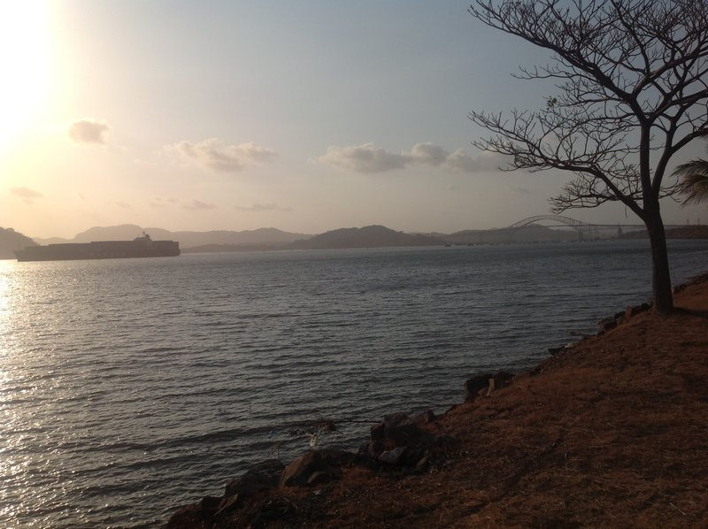 A large cargo ship, having just come through the Milaflores Locks (Pacific side) and under the Bridge of the Americas. Many of Panamas islands can be seen here.