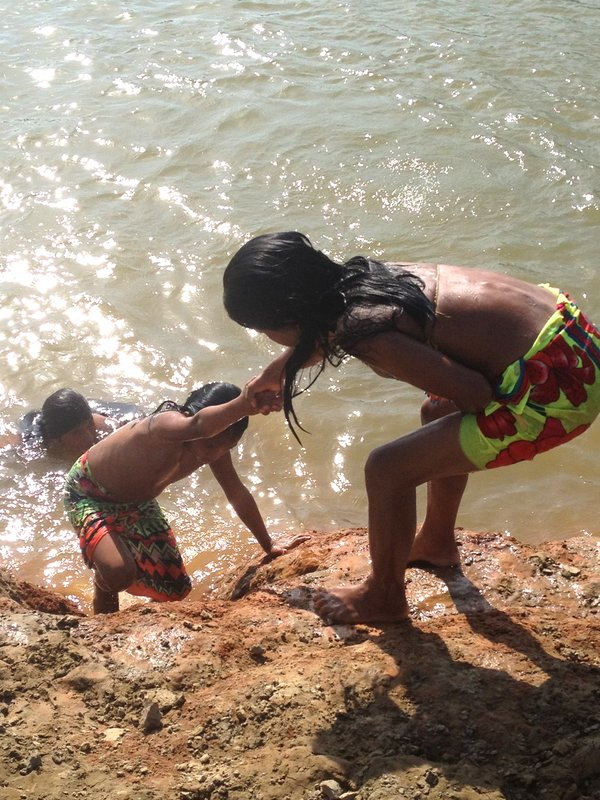 Swimming and playing on the banks of the Chagres River.