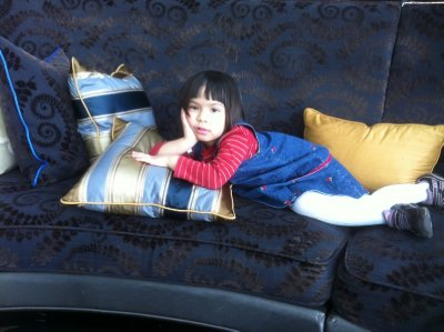 Ellie on a couch in the lobby of  St. Regis Hotel on the 96th floor