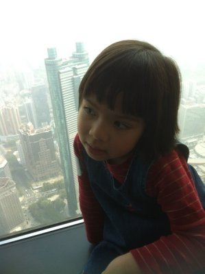 Ellie on the 96th floor of Kingkey 100