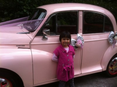 Ellie with the pink car