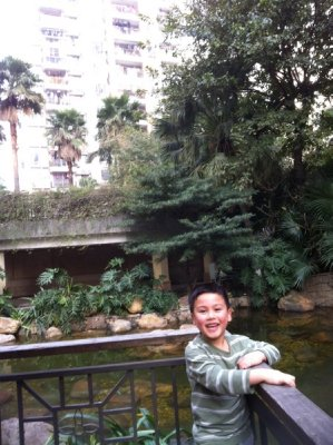 Skyler posing in front of a man-made pond