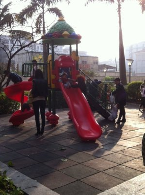 A small play structure that is always crowded
