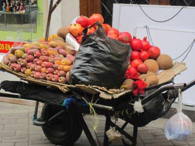 Whole or cut, buy my fruit. I've got cactus fruit, pomegrantes, mameys...