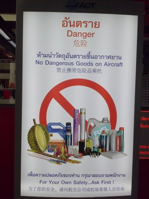 The infamous delicious but odiferous durian fruit is included as a dangerous object on this poster at Bangkok Airport!