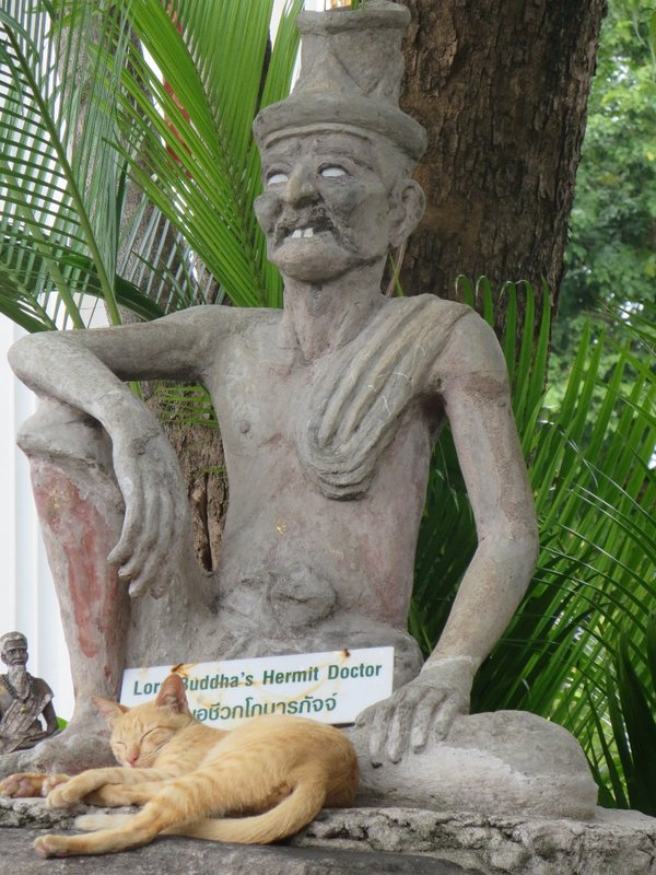 A statue of a hermit doctor that served Bhudda and his cat friend at Wat Pho in Bangkok.