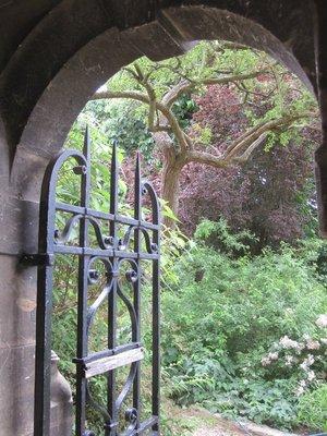 a very Alice-like gate to Merton gardens