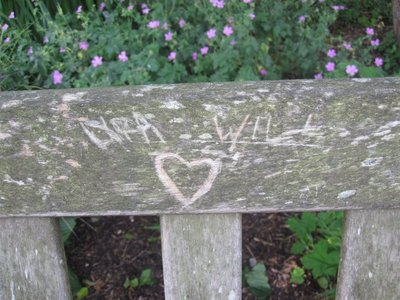 Lyra and will carved on the bench