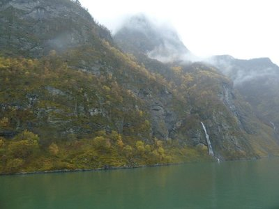 Waterfall near Undredal falling into the fjord