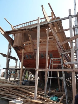 An Arab Dhow under construction at the Sur Boatyard