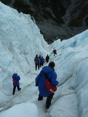 We make our down a crevasse on the Franz Josef Glacier