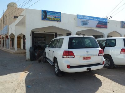 Garage specialising in deflating/inflating tyres coming on and off the soft sands of the desert