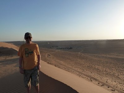 Me on top of a sand dune waiting for the desert sunset