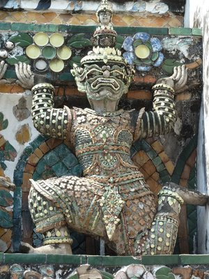 Detail of a scuptured figure on the side of Wat Arun