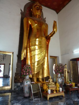 Standing Buddha in one of the surrounding halls at Wat Pho