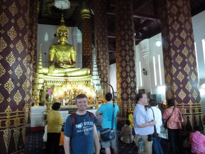 Me by the Buddha in the Temple at Wat Na Phra Mane