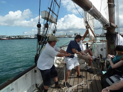 Hoisting the Sail aboard the Ted Ashby in Waitemata Harbour off Auckland