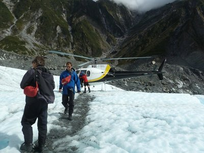 Hikers disembarking onto the ice from the helicopter