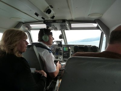 Our pilot scans the horizon looking for giant sperm whales