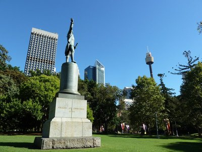 Captain Cook's Statue in Hyde Park with the Sydney Tower Eye  amongst the skyline in the background