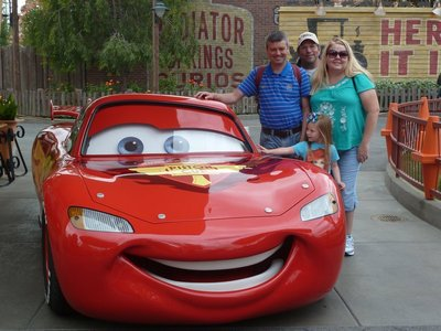Posing for a photograph beside 'Lightning McQueen' from the Disney Cars Film