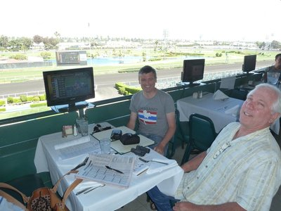 Studying the Form (and Menu) at our table on the Turf Club Terrace of the Hollywood Park Race Track