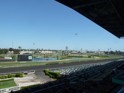 Hollywood Park Race Track with a plane coming into land at LAX overhead