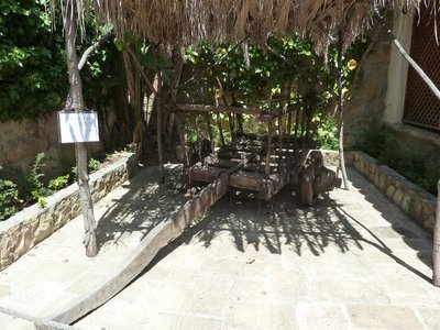 An old ox cart on display inside the Santa Barbara Mission