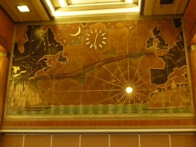 Ornate map on the back wall of the First Class Restaurant used to show the location of the Queen Mary while crossing the Atlantic
