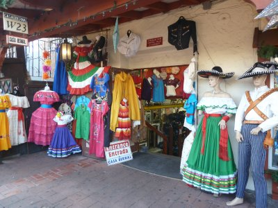 Colourful Mexican clothes on display outside a shop in Olvera Street