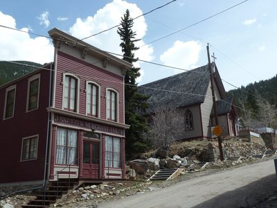 The Snetzer Tailor Shop and the Grace Episcopal Church on Taos Street