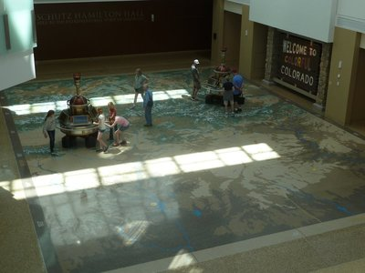 Moving the time machines around the Map of Colorado on the ground floor of the History Colorado Center