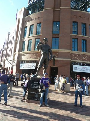 Me posing with my ticket by the player statue outside the stadium before the game
