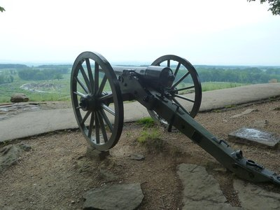 The boulders of Devil's Den viewed from behind a canon on Little Round Top