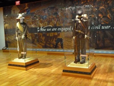 Rebel Grey and Union Blue Infantry Uniforms on display outside the museum