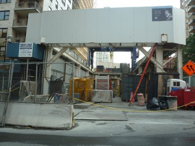 Surface gantry crane above a very big hole down to the tunnel construction work on 2nd Avenue