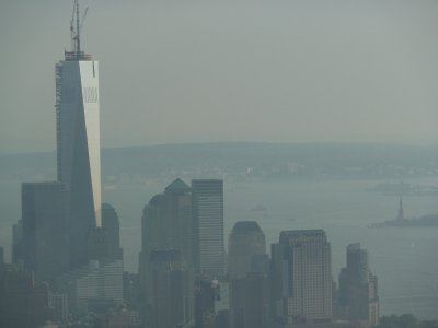 Close up of One World Trade Center and the Statue of Liberty from the 86th floor