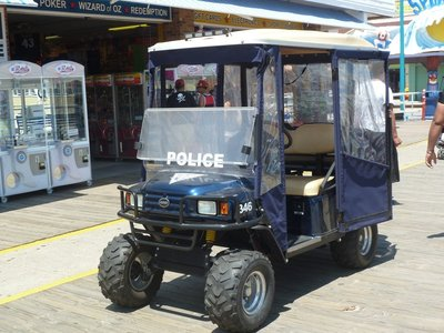 Police cart outside an amusement arcade on the Wildwood Boardwalk