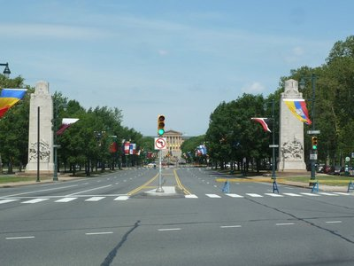 The view along the flag lined Benjamin Franklin Parkway towards the Philadelphia Museum of Art