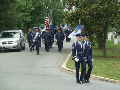 The Honor Guard leading a funeral cortege at Arlington National Cemetery