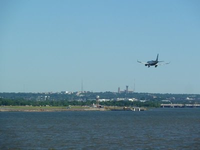 A passenger jet coming into land over the Potomac River at Ronald Reagan National Airport